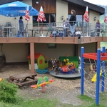 Playground for small children with carousel by the Wirzweli cable car mountain station